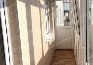 Балкон под ключ стандартного размпра в 6 метров динной с панорамным остеклением