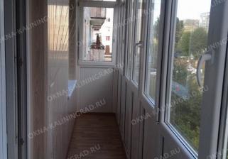 """Комплексный ремонт балкона под ключ с обшивкой стен сайдингом цвета """"Береза"""", класс Стандарт"""